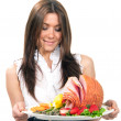 Woman holding a plate with turkey ham — Stock Photo #5483974