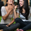 Stock Photo: Two Girls sharing Stories