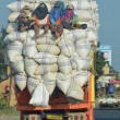 Truck overloaded with rice sacks — Stock Photo