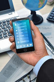 Business application on smart phone — Stock Photo