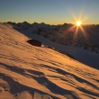 Stock Photo: Dawn over the snow-capped mountains. Caucasus