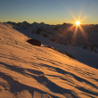 Dawn over the snow-capped mountains. Caucasus — Stock Photo