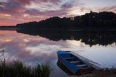 Beautiful dawn at the lake with a boat — Fotografia Stock