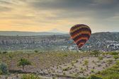 Balloon in Cappadocia over the vineyards — Stock Photo