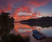 Panorama of beautiful dawn on lake with boat — Stock Photo