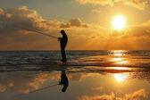 Reflection of a fisherman at dawn — ストック写真
