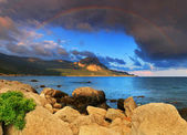 Rainbow over the ocean bay — Stock Photo