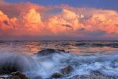 Stormy sunrise in ocean bay — Stock Photo