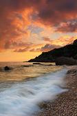 Puesta de sol en la playa del mar — Foto de Stock