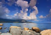 Panorama of ocean bay with rainbow — Stock Photo