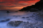 Panorama of sunrise over the sea in the bay — Stockfoto