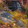Autumn waterfall in the park — Stock Photo