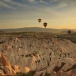 Hot air balloon flying over rock landscape at Cappadocia Turkey — Stock Photo