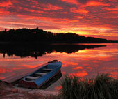 Panorama of sunrise over the lake — Stock Photo