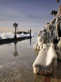 Ice on the bench after the storm — Stockfoto