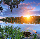 Colorful sunrise in the spring on the lake — Stock Photo