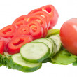 Sliced red pepper and cucumber with tomato on lettuce leaves iso — Stock Photo