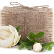 Soap with flowers in sacking cloth isolated on white background — Stock Photo