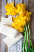 Bar of soap on sacking cloth with flowers — Stock Photo