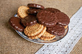 Coockies in a plate on a sacking cloth — Stock Photo