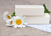 Soap on natural sacking cloth with flowers — Stock Photo