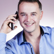 Cheerful businessman on the phone. — Stock Photo
