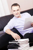 Successful businessman working at home. — Stock Photo