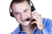 Businessman in blue shirt, a headset with a phone call. — Stock Photo
