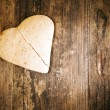 Broken heart cake on wooden table. — Stock Photo