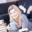 Stock Photo: Beautiful smiling blonde girl student.