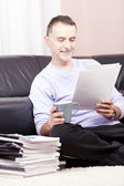 Successful businessman working at home. — Foto de Stock