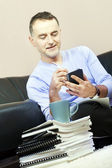 Successful man working at home. — Stock Photo