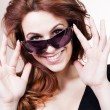 Beautiful young woman with sunglasses smiling. — Stock Photo