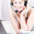 Blond girl talking on the headset. — Stock Photo