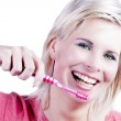 Attractive blonde girl with tooth care. — Stock Photo #26863453
