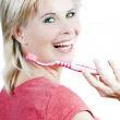 Attractive blonde girl with tooth care. — Stock Photo #26863561