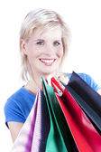Happily purchase of an attractive blond girl. — Stock Photo
