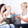 The living room is the mother of the child and the grandmother. — Stock Photo