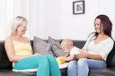 Family in living room with baby boy. — Stock Photo