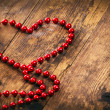 Stock Photo: Red heart shape pearl necklace.