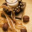 Festive candle surrounded by nuts and tape. — Stockfoto