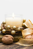 Festive candle surrounded by nuts and tape. — Foto Stock