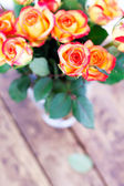 Gifts bouquet of roses on the table. — Stockfoto