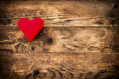 Red heart symbol on a rustic wooden planks. — Stock Photo