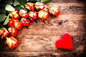 Valentines Day background with roses and hearts. — Stock Photo