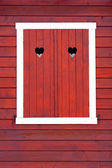 Closed window shutters, red color, — Stock Photo