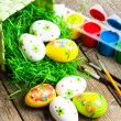 Stock Photo: Painted Easter eggs on wooden background.