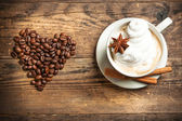 Delicious cup of coffee in a rustic background. — Stock Photo