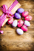 Painted Easter eggs on wooden background. — Stock Photo