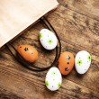 Easter eggs painted on the wooden background. — Stock Photo #42860907